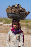 Cow dung, the fuel and and woman in India Royalty Free Stock Images