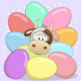 Cow with eggs Royalty Free Stock Photography