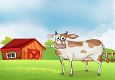 A cow in the farm with a wooden house at the back royalty free illustration