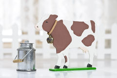 Cow figure with milk can Stock Photo