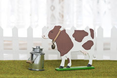 Cow figure with milk can Stock Photography