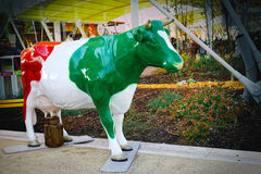 Cow flag, statue representation of the milking Royalty Free Stock Photo