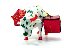 Porcelain cow carrying gifts Stock Photo