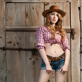 Cow-girl d'une chevelure rouge Images stock