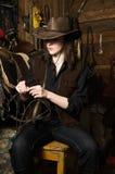 Cow-girl dans les gammes de produits Photographie stock libre de droits