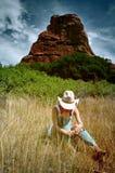Cow-girl dans les montagnes Image stock