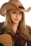 Cow-girl et sa guitare Image stock