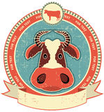 Cow head label on old paper texture. Stock Image