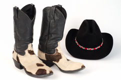 Cow Hide Cowboy Boots and Stetson Hat. Cow Hide (Hair-On) Cowboy Boots and Cowboy Hat with colorful Hatband Royalty Free Stock Photography