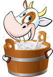 Cow holding a pail full of milk - vector Stock Image