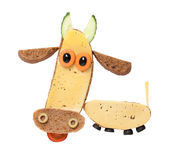 Cow made of black bread and cheese. Cow created from black bread, cheese, olives and carrot. Easy and creative way to make funny sandwich. Shot with Canon 5D Royalty Free Stock Image