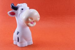 The cow is made of rubber. On a green background Stock Photography