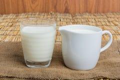 Cow milk and ceramic jug Stock Image