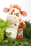 Cow with milk and greenery. On an east calendar 2009 year - year of bull Royalty Free Stock Photo