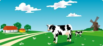 Cow & mill Stock Image