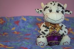 Cow with ornament for a new year tree stock photo