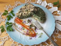 Cow parsley omelet on plate, Cooking with ginger, wild plants, goutweed Stock Photography
