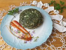 Cow parsley omelet on plate, Cooking with ginger, wild plants, goutweed Stock Photo