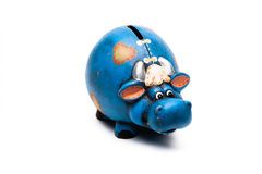 Cow piggy bank. Blue cow piggy bank isolated on a white background Stock Images