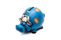 Cow piggy bank. Blue cow piggy bank isolated on a white background Royalty Free Stock Photography