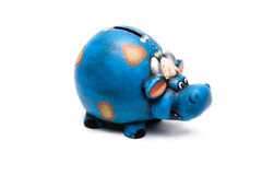 Cow piggy bank. Blue cow piggy bank isolated on a white background Royalty Free Stock Photos