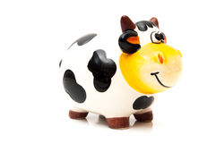 Cow piggy bank. On a white background Stock Photos