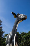 Cow sculpture with blue sky. Funny cow sculpture with blue sky found besides the highway from Korat stock image