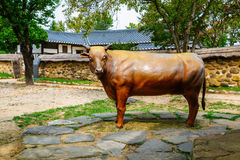 Cow sculpture and Korean traditional architecture in Cheongpung Cultural Heritage Complex Royalty Free Stock Photography