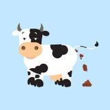 Cow shitting Stock Image