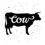 Cow silhouette 005. Cow silhouette with a calligraphic inscription `Cow` on a grunge background. Vector illustration Stock Photography