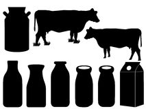 Cow silhouette and milk bottles Stock Image