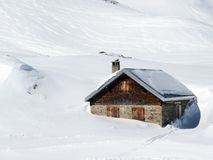 Cow Stable sunk in the deep snow Royalty Free Stock Image