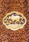 Cow wood Carving Wall sculptures in thai temple Stock Image
