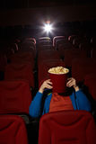Coward in the cinema Royalty Free Stock Photography