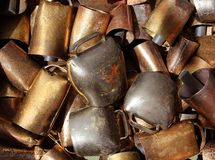 Cowbell bell pattern texture in market shop. Golden color stock image