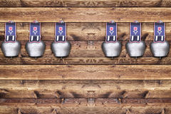 Cowbells on wooden board Royalty Free Stock Image