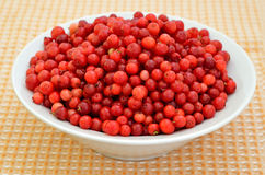 Cowberry in the white bowl Royalty Free Stock Photos