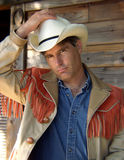 Cowboy. Man in cowboy hat and fringed jacket Royalty Free Stock Image