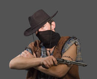 Cowboy. With revolver isolated on grey background.Shallow DOF Stock Images
