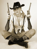 Cowboy. Sexy cowgirl with old-fashioned gun Stock Image