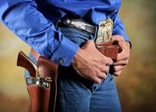 Cowboy. Waist section of a western era cowboy with gun and holster Stock Photo