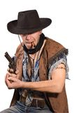 Cowboy. With revolver in his hand  on white background Stock Photo