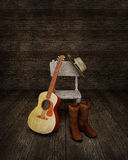 Cowboy absence. Illustration of an empty chair on which is resting a cowboy hat, with a pair of boots and a country guitar at its feet Royalty Free Illustration
