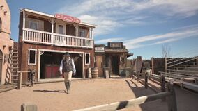 Cowboy actor approaches in Wild West town of Tombstone, Arizona