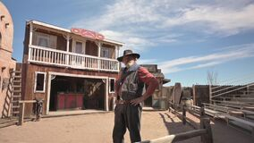An actor dressed as a cowboy fin Tombstone, Arizona