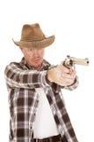 Cowboy aiming a gun Royalty Free Stock Photos