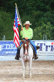 Cowboy with American flag. Stock Image