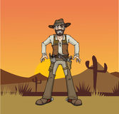 Cowboy. Angry Cowboy getting ready to shoot, with desert landscape background Royalty Free Stock Images