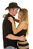Cowboy arms around woman heads close Stock Image