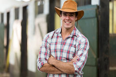 Cowboy arms crossed. Good looking cowboy with arms crossed in stable Stock Photos